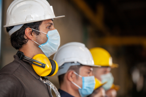 Masked engineers on job site during pandemic